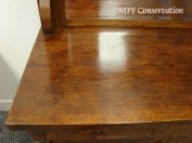 The original finish was cleaned thoroughly, and then shellac was added as infill and the top was finished with a mechado process.