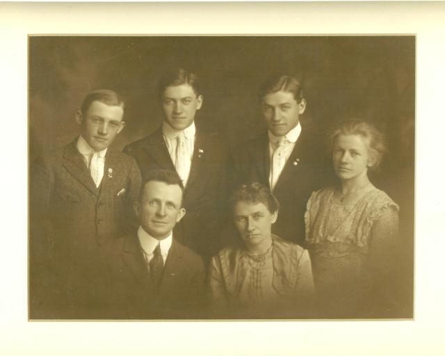 Great Grandma Hoyt is the woman bottom right; my grandmother Lyle is the woman behind her, with her brothers.