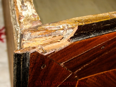 Desiccated broken top drawer edge.