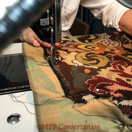 Stitching the seat onto the silk.