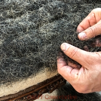 A small amount of hair is laid into the seam depressions.